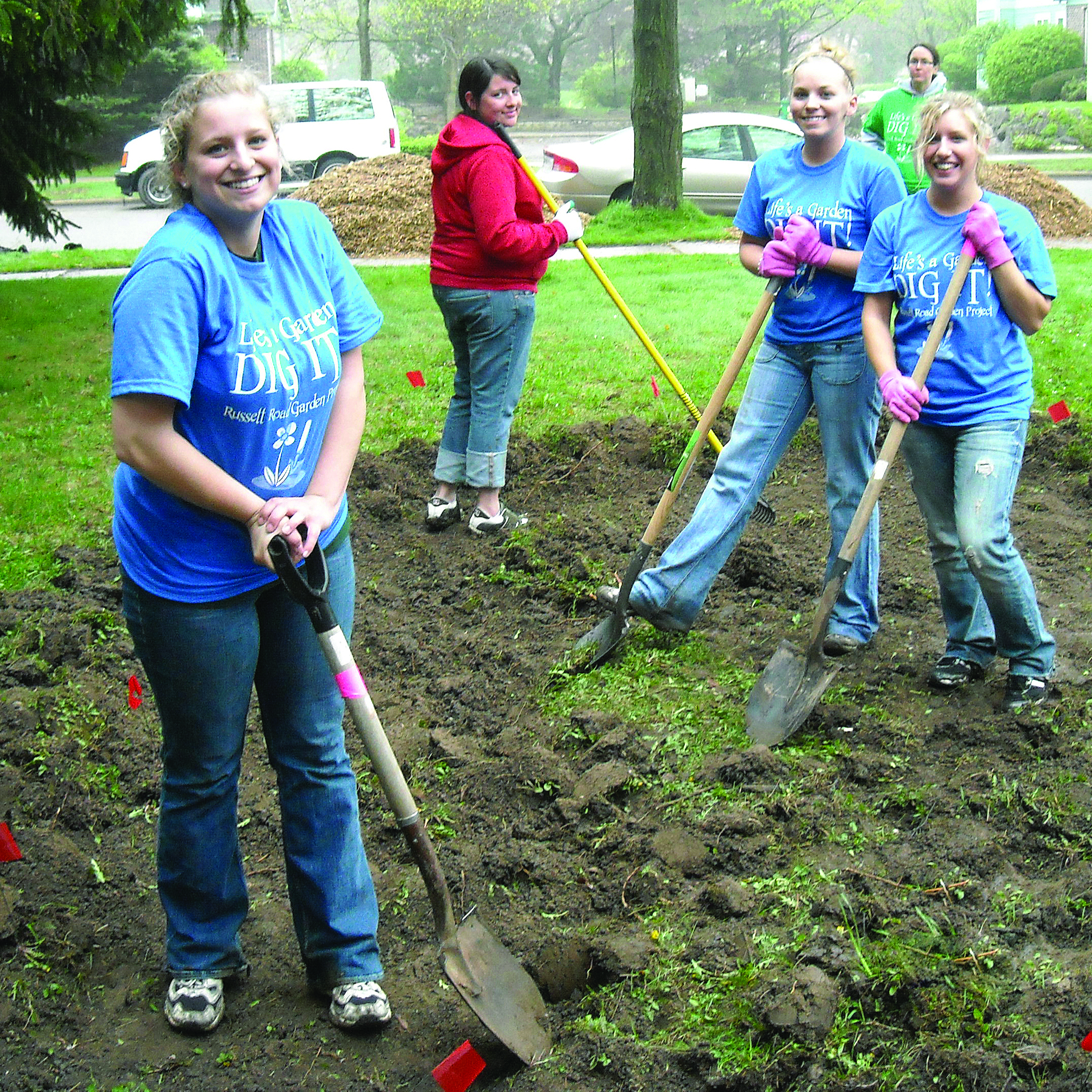 Edgewood College students gardening